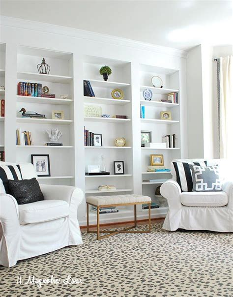 billy bookcase built in with doors create the look of high end built in bookcases on an empty