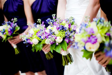 purple green wedding inspiration bridal bouquet with bridesmaids onewed