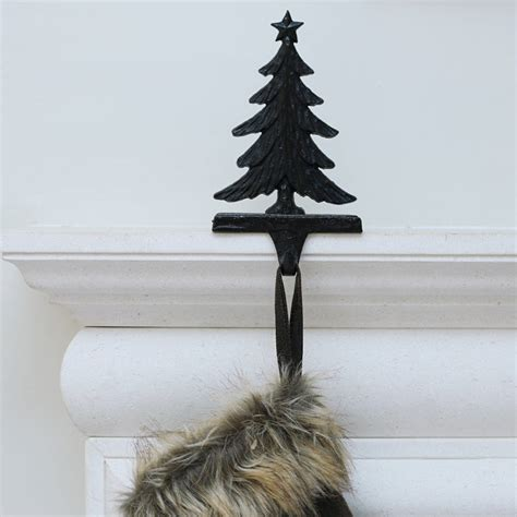 cast iron reindeer or tree stocking holder by ella james