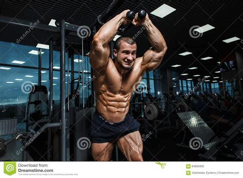 strong athletic man bodybuilder torso showing muscles