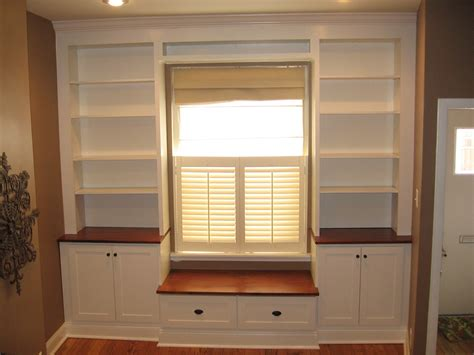 window bench and bookshelves built in around window with bench seat create toy storage