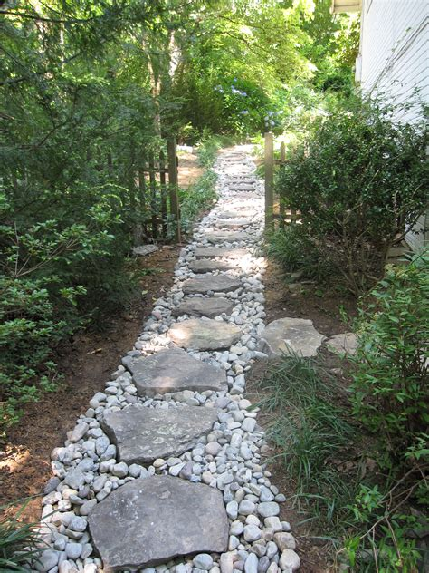 dry creek with boulder steppers side yard drainage