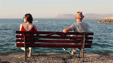 couple sitting on bench relationship difficulties couple sitting on bench by the