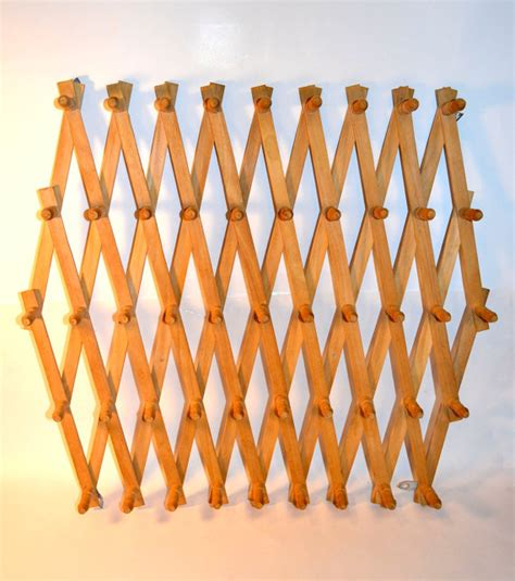 Expandable Peg Rack by The Ultimate Peg Rack Wooden Accordion Peg Wall By