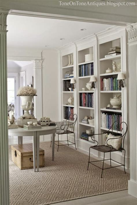 built in white bookcases color outside the lines delays bookshelves and cowhides