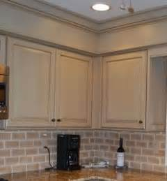 hide soffit above kitchen cabinets by adding crown molding hide kitchen soffit with molding and crown molding