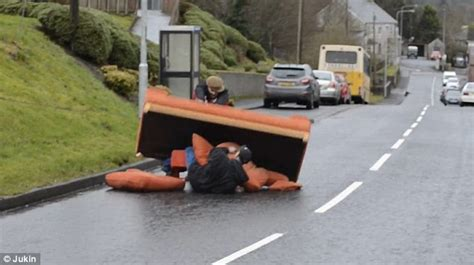 roadside couch chuckle brothers like angry men struggle to move a sofa on