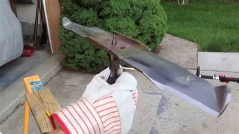 how to sharpen a lawnmower blade with a bench grinder how to sharpen and balance the blade on a lawn mower youtube