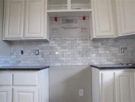 tile under kitchen cabinets do i need trim tile under the cabinets