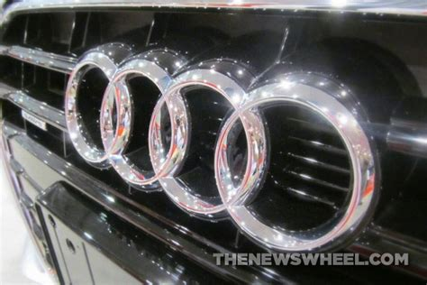 audi badge meaning the badge symbolism in audi s four rings logo