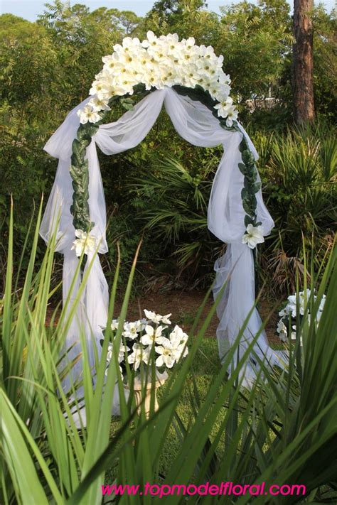 decorated arches  weddings magnolia wedding arch