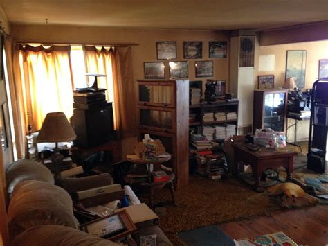 cluttered living room before and after winning remodel in victory heights