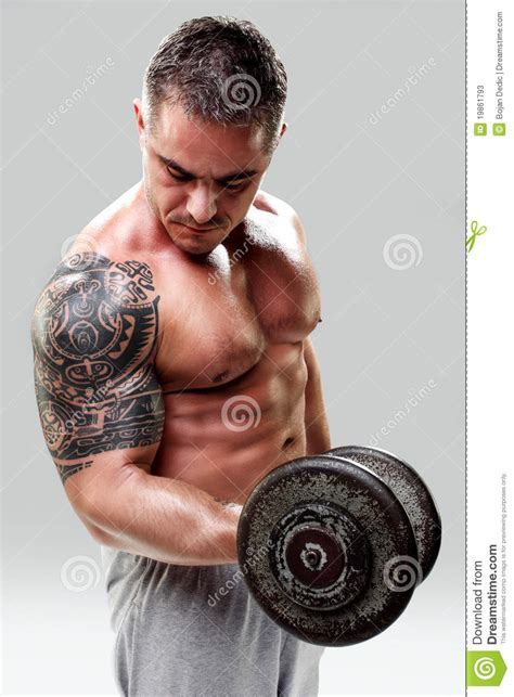 tattoo arm bodybuilding bodybuilder with a tattoo lifting weights closeup stock