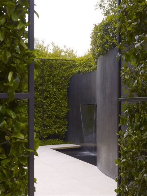 green garden walls garden water feature roundup gardenista water pours from a curved bronze wall in a san