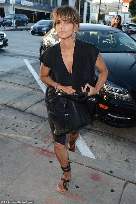 Get Halle Berrys Summery Sandals by Halle Berry Opts For Comfy Chic In Silky Black Dress While