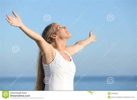 attractive blonde woman breathing happy  raised arms royalty  stock photo image