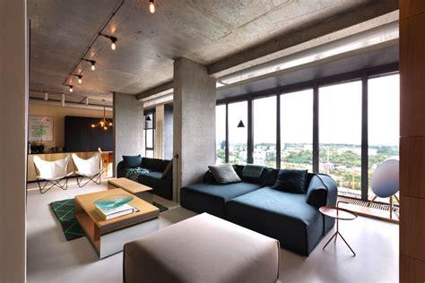 interior design a concrete apartment fresh green plants copper and concrete at apartment