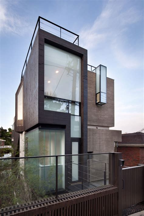 house glass window design gate exterior design glass window and wood wall small modern family house with brown