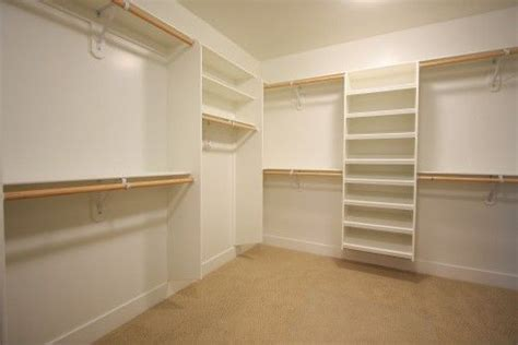 Simple White Shelves Simple White Closet With Floating Shelves And Racks
