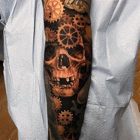 mechanical parts tattoo natural looking colored big old skull with mechanical