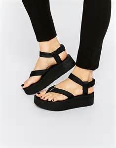 black sandals teva teva black flatform universal sandals at asos