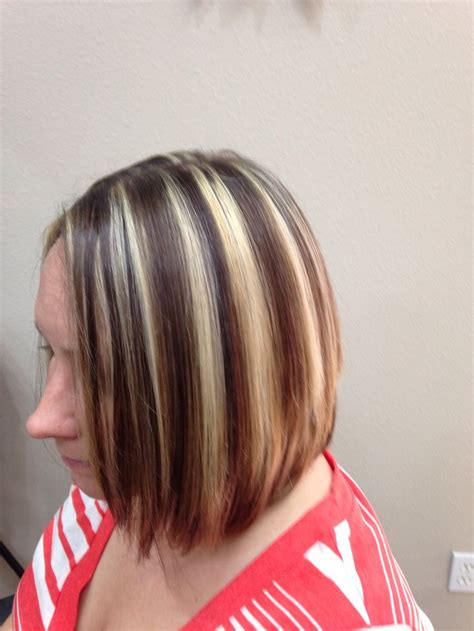 highlights and lowlighted blunt cut bob chunky highlights and lowlights cut into a line bob by