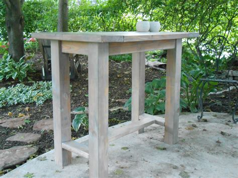 Outdoor Kitchen Table White Farmhouse Table Modified To Become An Outdoor Kitchen Island Diy Projects
