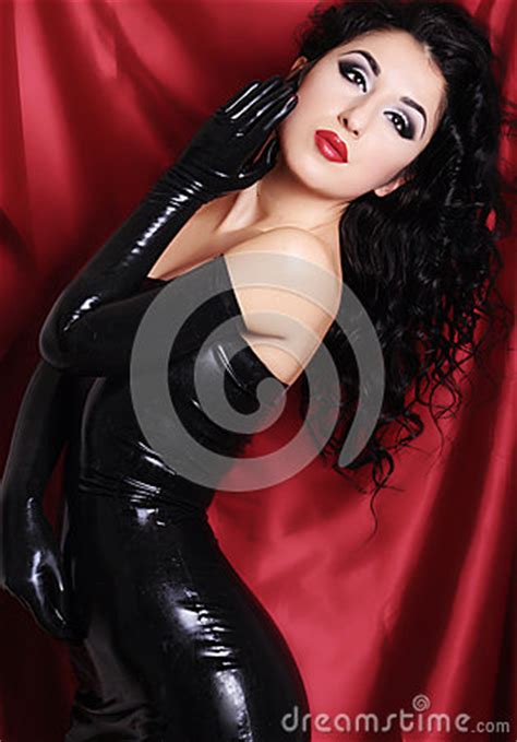 curling hair mistress woman wearing black latex outfit stock photo image 64217371