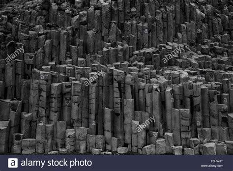 volcanic sand basalt geometrical column rock formations on the black