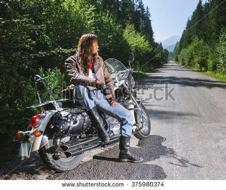 long hairstyles for a biker man motorcycle on open road stock photos royalty free images