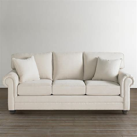 beige upholstered sleeper sofa