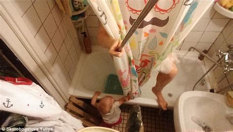 i cant even pee in peace where moms can get a little relief russian mother uses a selfie stick to capture her chaotic