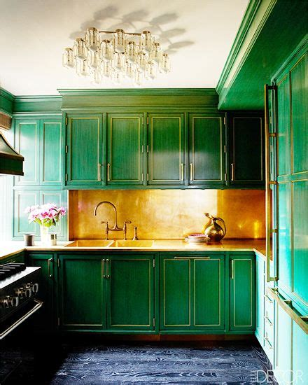 hint of green two tone kitchen with copper accents copper farm sink white painted wood 13 celebrities who know how to use color green cabinets