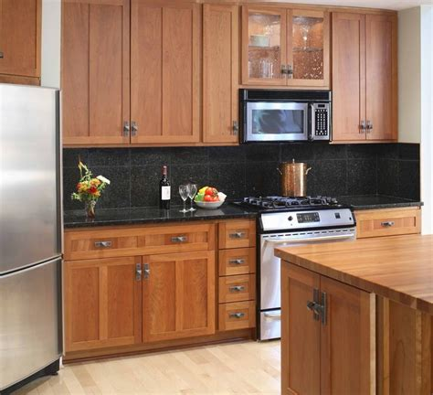 What Goes Where In Kitchen Cabinets | what color wood floor goes with maple cabinets good