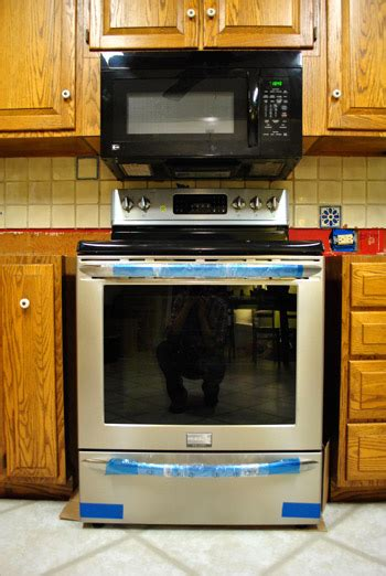 the range microwave without cabinet how to hide a microwave building it into a vented cabinet