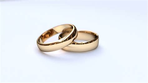 Wedding Clip Hd by Studio Of Two Wedding Rings Falling Against White