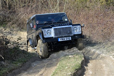 toyota land rover defender test land rover defender vs toyota land cruiser and