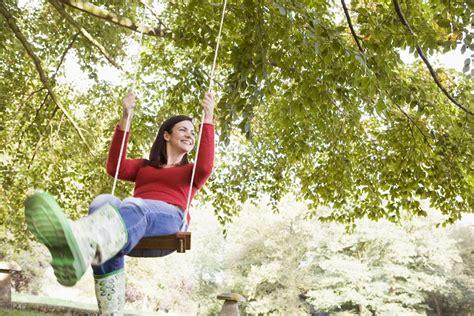 swinging tree hanging a backyard tree swing landscaping network