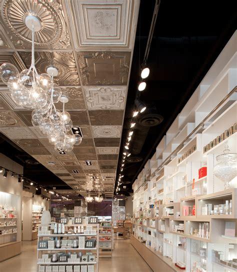 shop ceiling design cosmetics shop design ceiling l d skins 6 2 cosmetics shop by uxus design