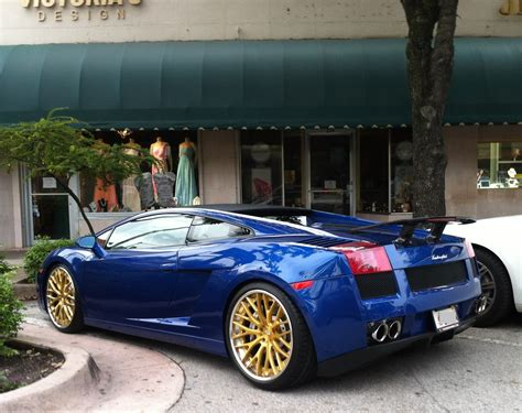 Blue Car Gold Wheels by Cars On The Streets Of Miami Blue Lamborghini
