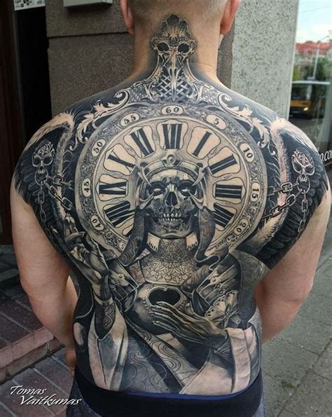 clock amp skull full back tattoo inkstylemag