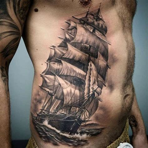 men side tattoos sailing ship side side tattoos