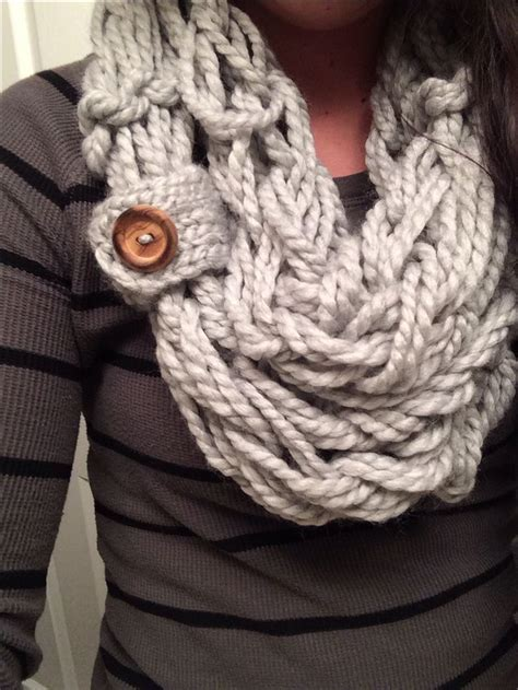 how to knit an infinity scarf arm knitted scarf with a button loop guess i m gonna