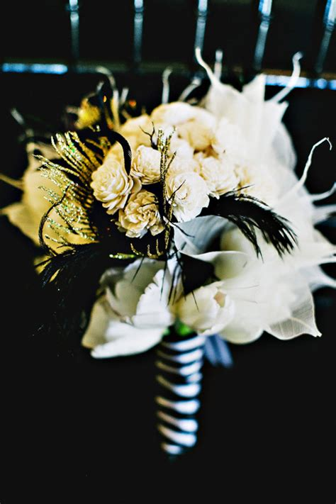 Fall Centerpieces With Feathers by 29 Luxurious Black And Gold Wedding Ideas