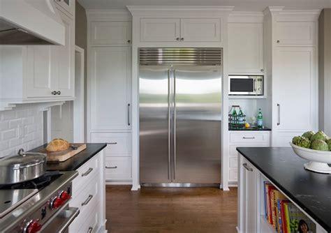 pale aqua pantry door white shaker cabinets black aqua grantique countertop kitchen sherwin williams