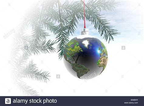 world globe ornament hanging from a christmas tree stock