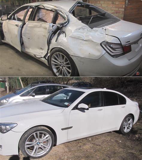 bmw car repair of auto repairman overhauling a totaled bmw