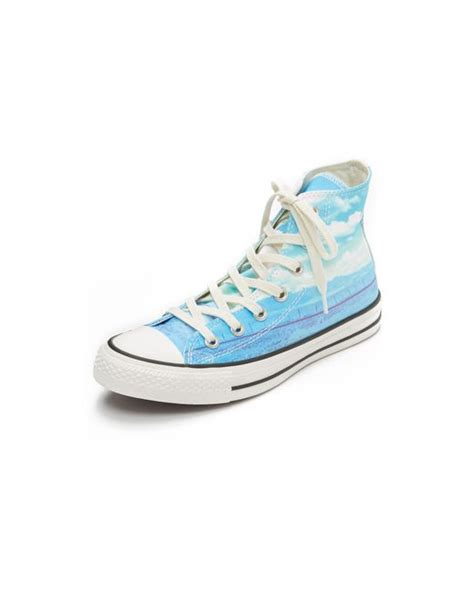 spray paint chuck taylors converse chuck all photo reel sneakers in blue