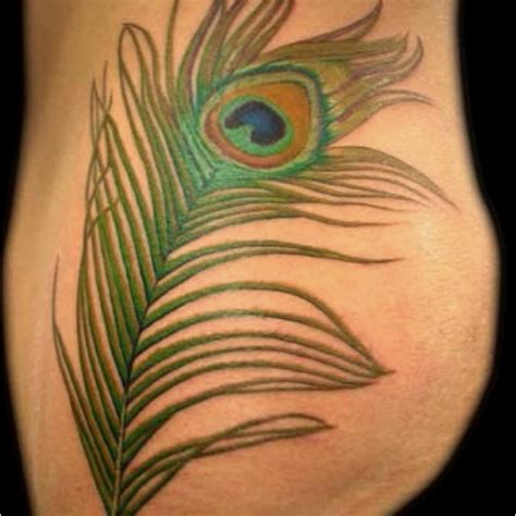 feather tattoo course getting this on my side opposite of the one already