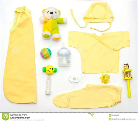 Top Baby Yellow top view of baby yellow clothes and stuff stock